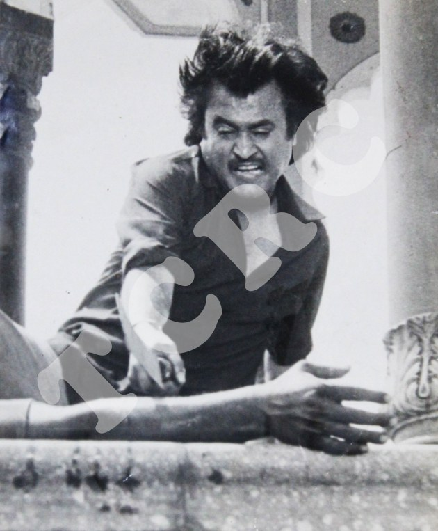 "Rajnikanth in an action sequence from Mani Ratnam's ""Thalapathi."""